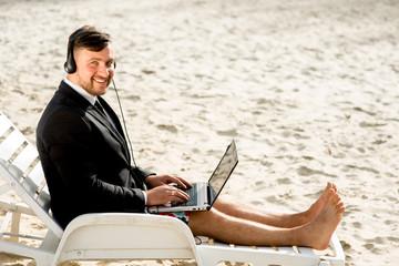 Businessman on the beach