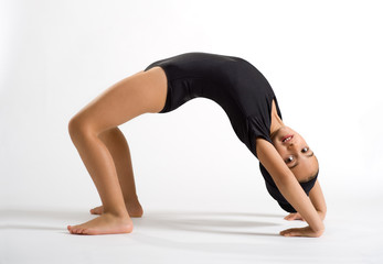 Supple girl bending backwards to form a bridge