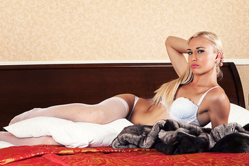 attractive woman lying on the bed in lingerie
