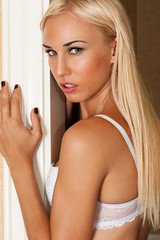 portrait of a beautiful blond woman in a white bra