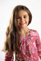 Pretty vivacious little girl with long brown hair