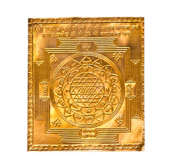 Golden yantra on white.Manufactured from copper plate