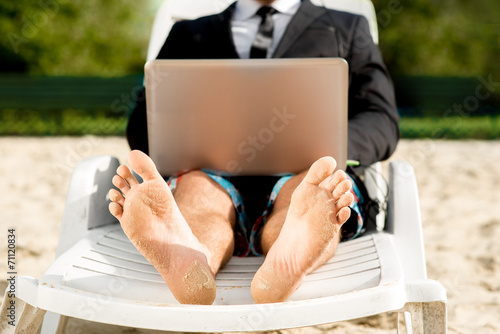 Businessman on the beach - 71120834