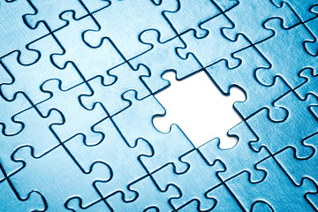 Puzzle with missing piece.