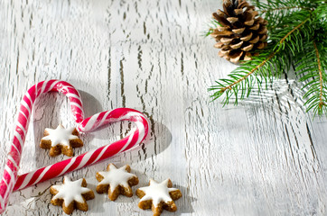 Christmas decoraion with candy canes and star cookies copy space