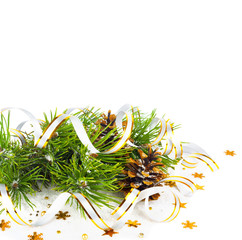 Christmas fir branch with pine cones, gold streamers and stars o