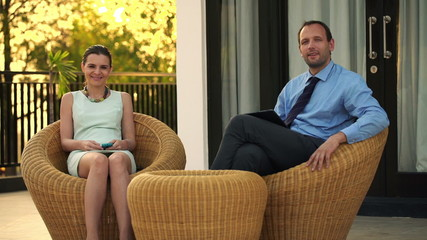 Portrait of successful, smiling business couple with smartphone