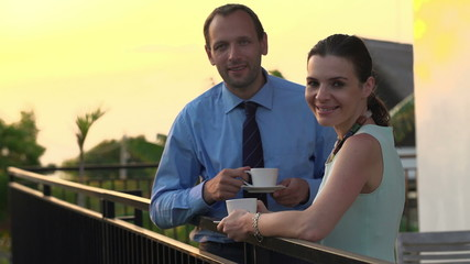Portrait of happy, smiling business couple drinking coffee on te