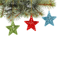 Christmas fir branch with   multicoloured, stars on a white back