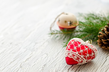 Christmas decoraion greeting card with red heart and cone
