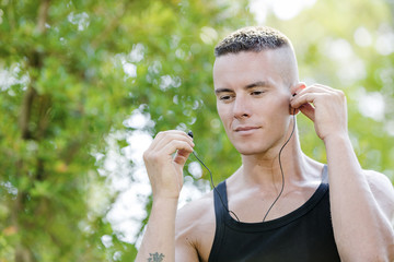 Man listening music during sport at the Park