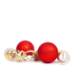 Red Christmas balls with golden streamer isolated on a white bac