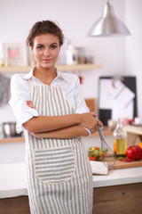 Woman with corolla standing in the kitchen