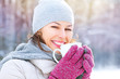 Beautiful happy smiling winter woman with hot drink
