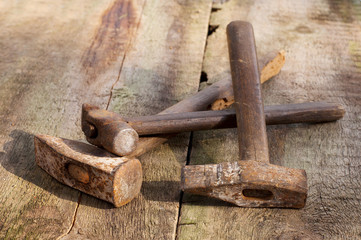 old vintage building tools on a wooden background