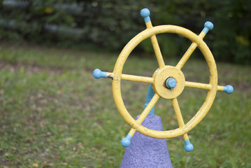 old steering wheel on the playground