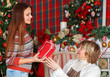 Grandmother with granddaughter celebrating Christmas