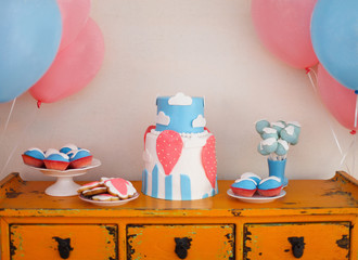Sweet table with big cake, cupcakes, cake pops