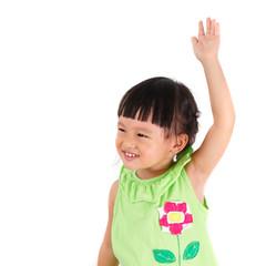 little girl raise left hand