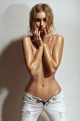 Young topless girl in jeans.