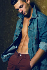 Male beauty concept. Portrait of handsome muscular male model in
