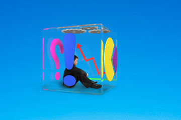 man sitting in glass cubic
