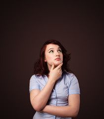 Young woman thinking with copy space
