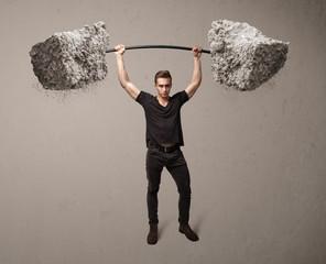 muscular man lifting large rock stone weights