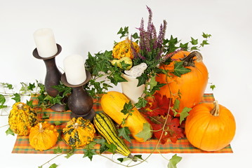 Decoration with pumpkins, candle and heather
