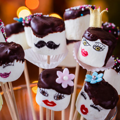 Funny marshmallow pops with chocolate hair