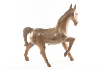 wooden horse is on a white background