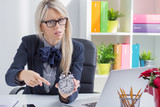 Frustrated business woman is angry about being late at work
