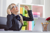 Happy young business woman enjoying success at work poster
