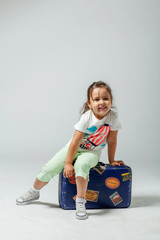 girl on a suitcase