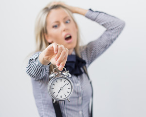 Stressful and frustrated woman holding alarm clock