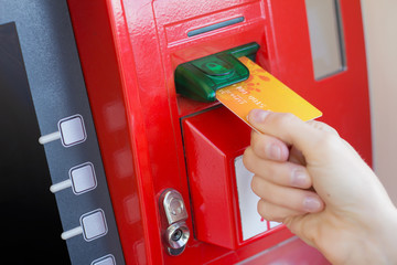 Inserting credit card into ATM