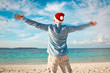Man in santa hat on the tropical beach