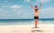 Man in santa hat on the tropical beach