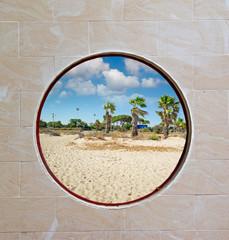porthole by the sea