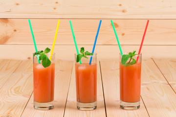 Grapefruit juice on table.