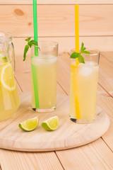 Lemonade fresh on wooden board.