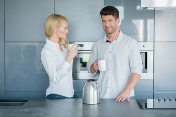 Attractive couple enjoying their morning coffee