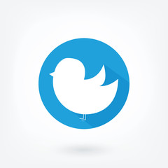Social bloging bird icon in blue circle on white background