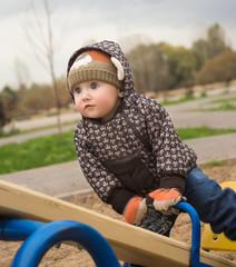 Little boy plays childrens playground