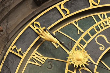 Astronomical clock in Prague in puddle