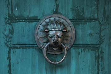 Antique door handle in the form of a lion