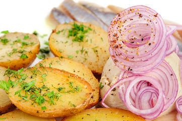 Roast potatoes with hering and onion