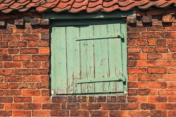Worn Small Wooden Door set in Old Bricks