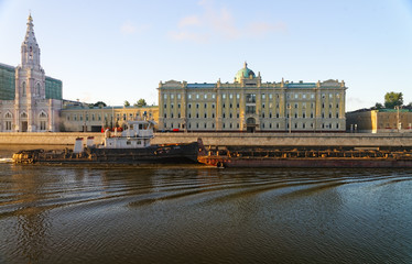 Tow boat in the Moscow river in front of major russian oil compa