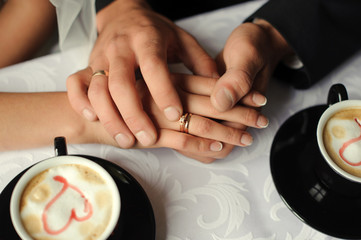 Hands of married people. Coffee.